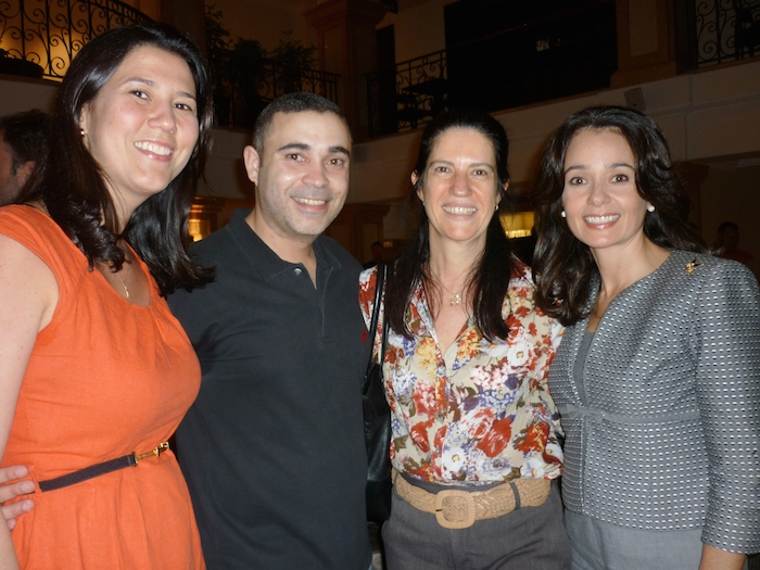 Risa Batista (Osep) and Glorisabel Garrido (NBCC) with other happy hour attendants.